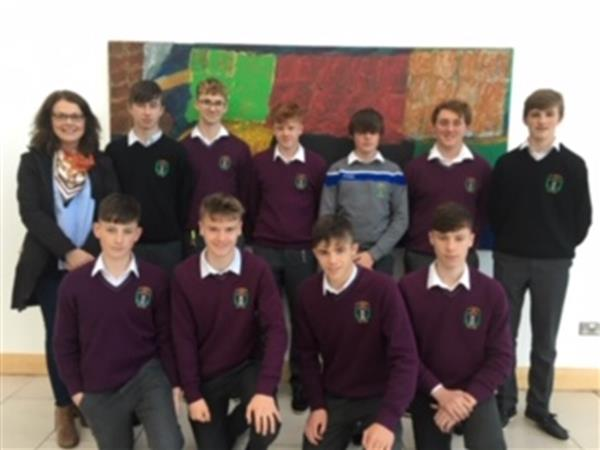 The Debating Team from St. Joseph's CBS and their mentor and teacher, Ms Alison Collins pictured at their recent visit to UCC